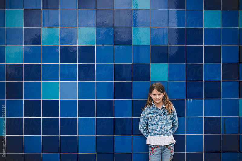 A girl and a blue wall by Courtney Rust for Stocksy United