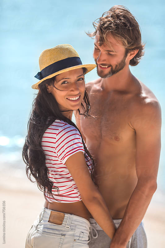 Happy Couple on the Beach by Lumina for Stocksy United