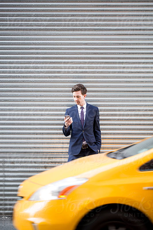 Businessman on his phone in the city by Ann-Sophie Fjelloe-Jensen for Stocksy United