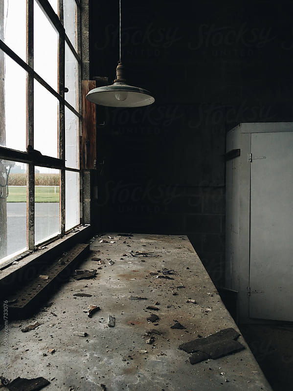 Interior photos of an old abandoned dirty empty garage by Greg Schmigel for Stocksy United
