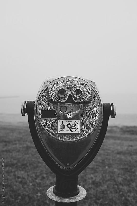 Binocular telescope camera on a foggy beach during the winter months in Maryland by Greg Schmigel for Stocksy United