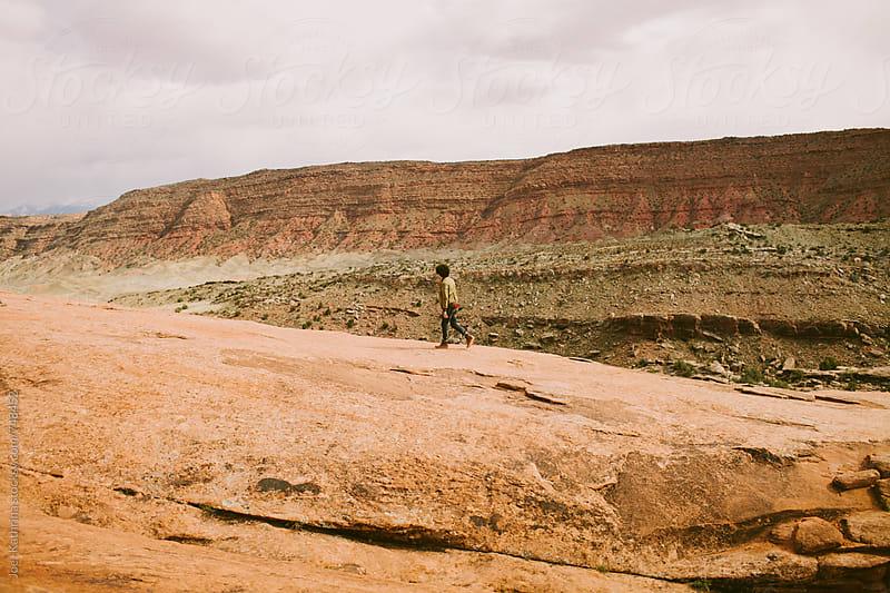 man walking up a canyon. by Joe+Kathrina for Stocksy United