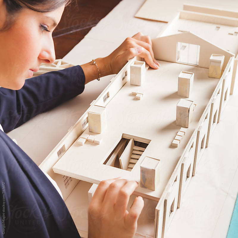 Young Female Architect Studying an Housing Model Made of Cardboard by Giorgio Magini for Stocksy United