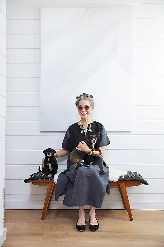 Portrait of stylish senior woman with her pet dogs  by Trinette Reed for Stocksy United