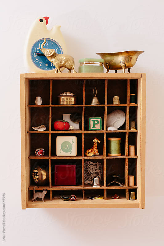 shadowbox display of knick-knacks by Brian Powell for Stocksy United