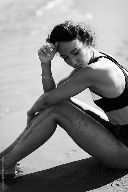 woman relax on the beach by Alexey Kuzma for Stocksy United