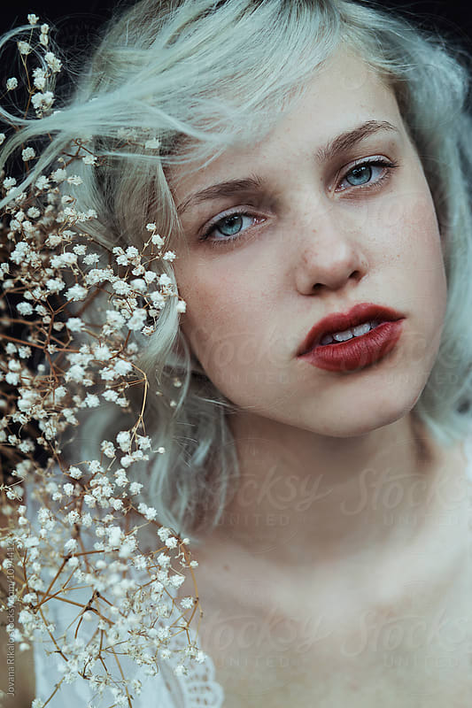 Portrait of a beautiful young woman with blue eyes by Jovana Rikalo for Stocksy United