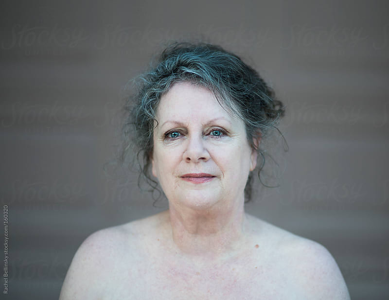 Bare portrait of a mature caucasian woman by Rachel Bellinsky for Stocksy United