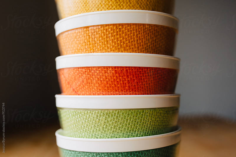 Colorful burlap bowls stacked by Jessica Byrum for Stocksy United