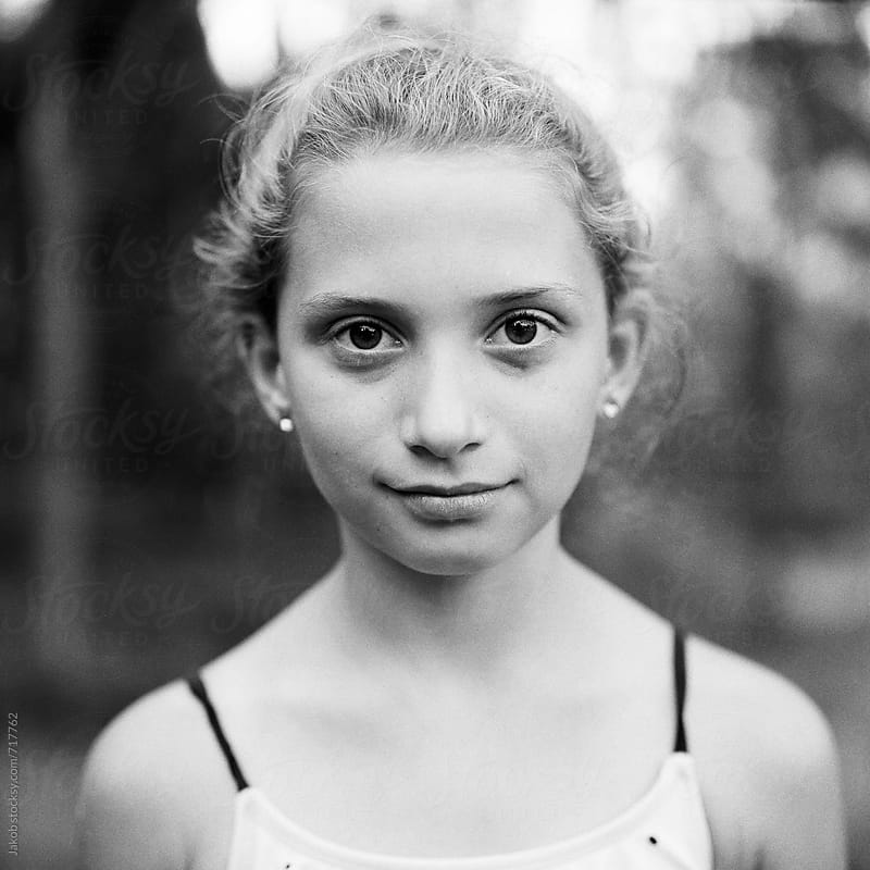 Black and white portrait of a beautiful young girl by Jakob for Stocksy United