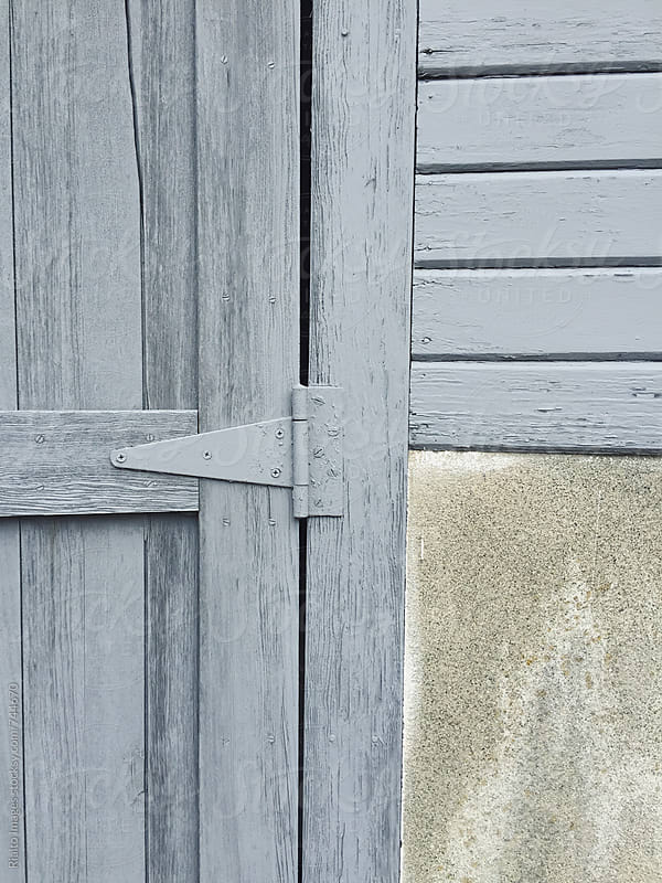 Detail of painted grey wood doors, close up by Paul Edmondson for Stocksy United