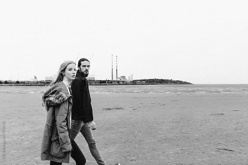 Teenage Young Couple Walking on the Beach in Autumn Time by HEX . for Stocksy United