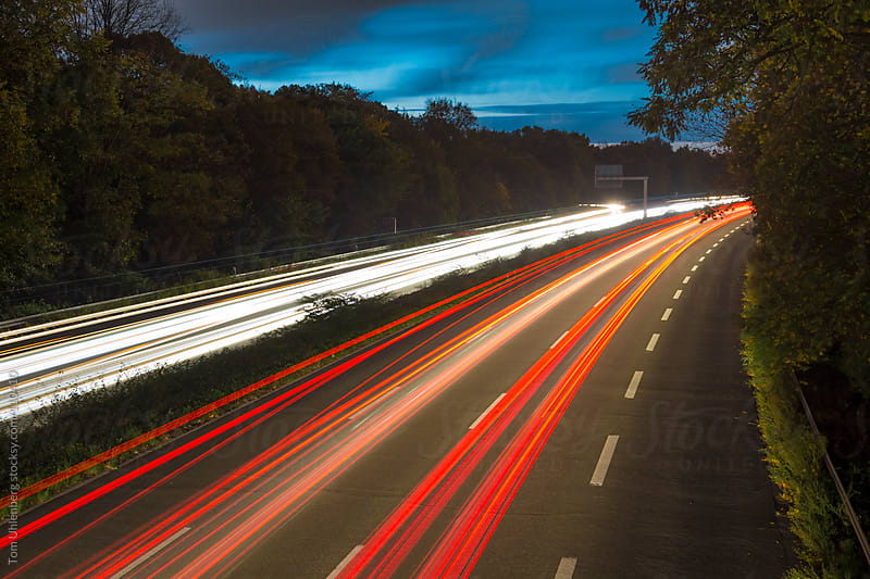 Light Trails of Cars on a Highway by Tom Uhlenberg for Stocksy United