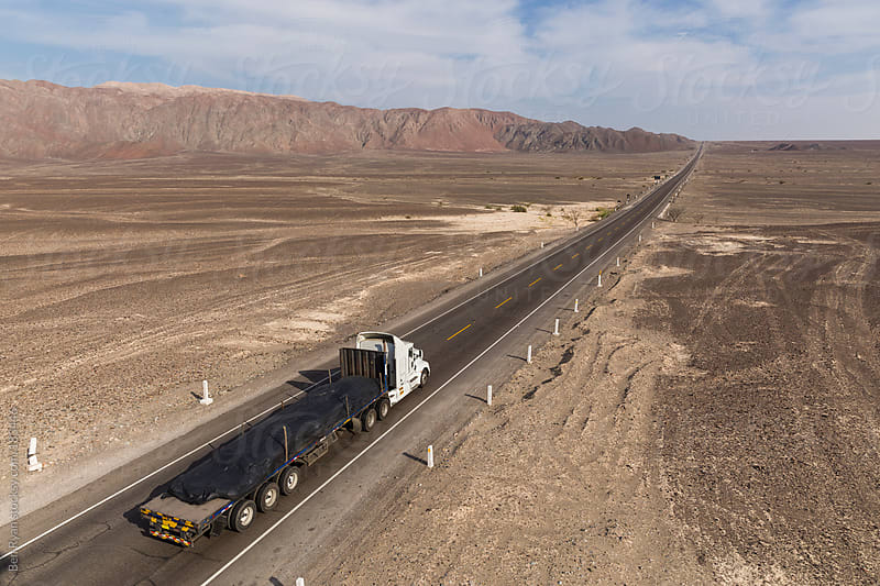 Panamericana Sur with truck, stretches away across Nazca desert Peru by Ben Ryan for Stocksy United