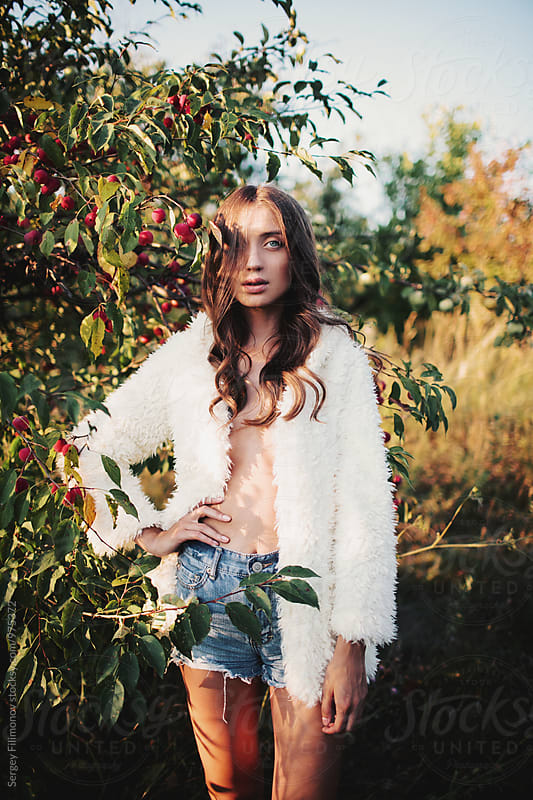 Young beauty brunette woman in white furry jacket  by Sergey Filimonov for Stocksy United
