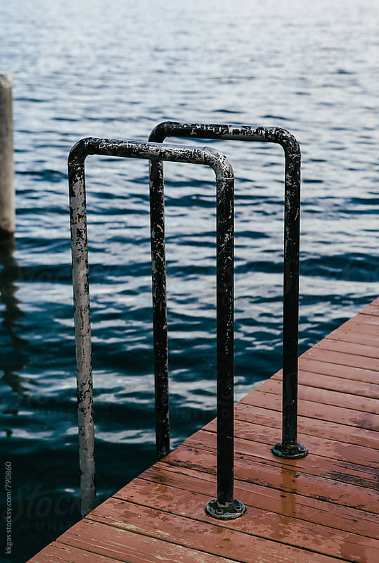 Metal handrails on a wooden pier by kkgas for Stocksy United