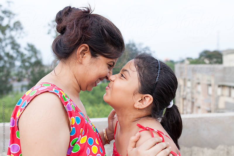 Mother and daughter interacting with each other by PARTHA PAL for Stocksy United