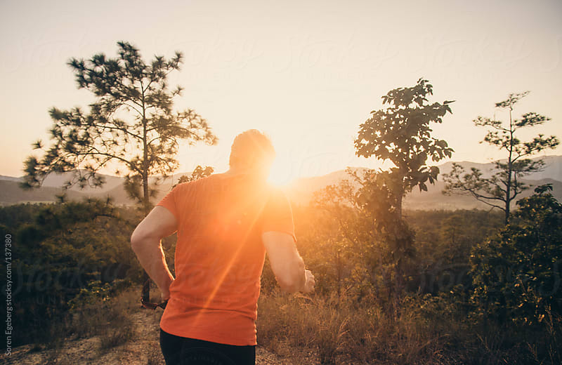 Sunset runner outdoors by Soren Egeberg for Stocksy United
