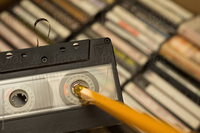 Pencil being used to rewind tape in cassette by David Smart for Stocksy United