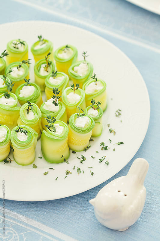 Zucchini with goat cheese and thyme by Borislav Zhuykov for Stocksy United