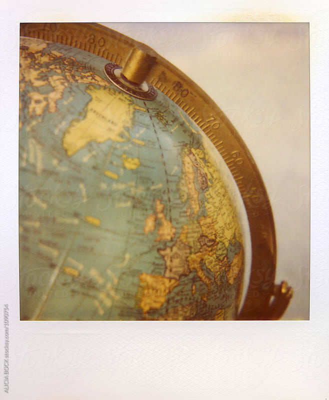 Polaroid Photograph Of A Vintage Globe by ALICIA BOCK for Stocksy United