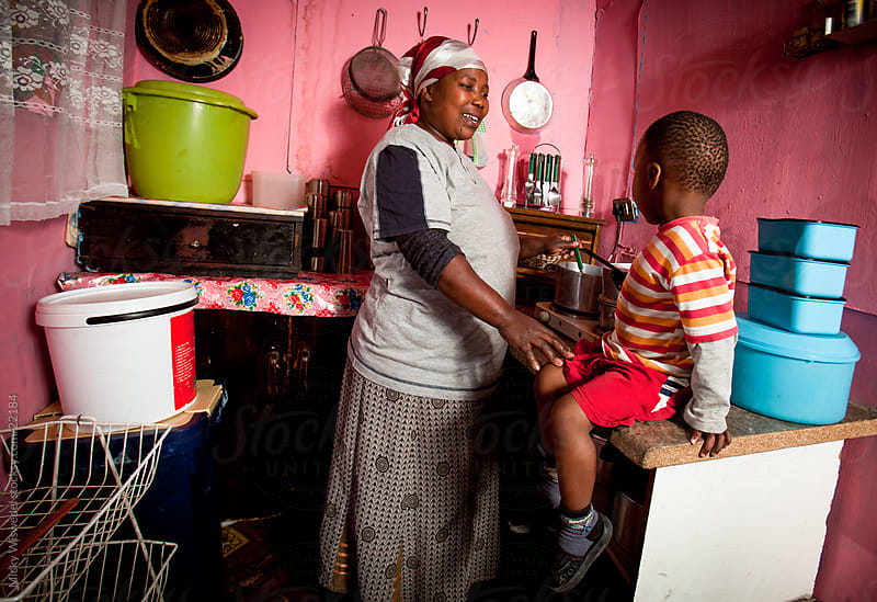 African Mother and Child in the Kitchen by Micky Wiswedel for Stocksy United