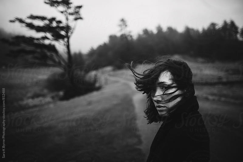 A girl visiting the Oregon coast by Sara K Byrne Photography for Stocksy United