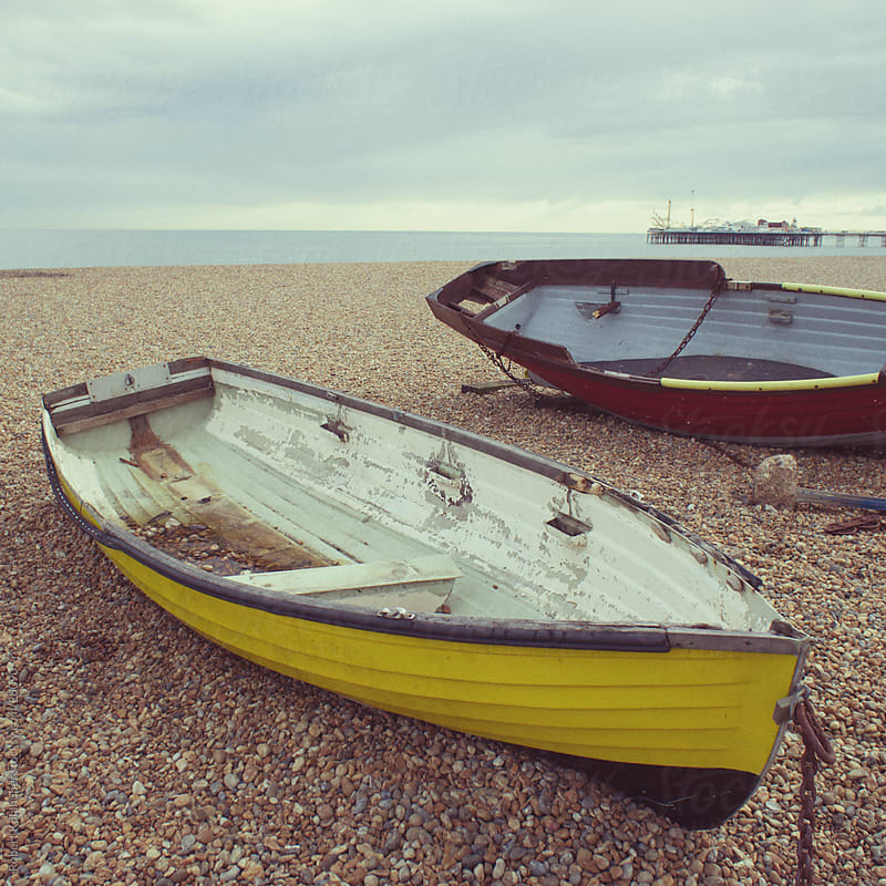 Two boats on the beach in Brighton, UK by Robert Kohlhuber for Stocksy United