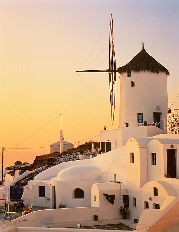 Windmill of Oia at sunset. Santorini. Greece. by Hugh Sitton for Stocksy United