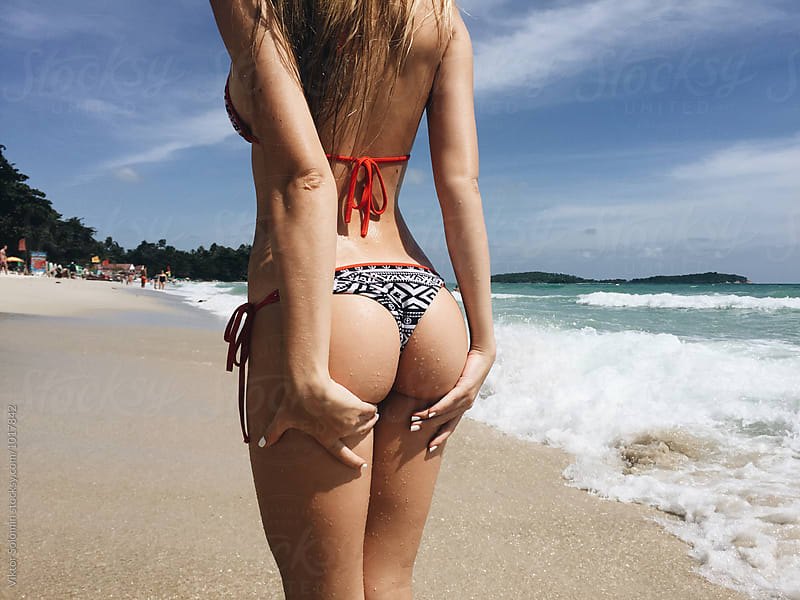 Sexy back on the beach in bikini  by Viktor Solomin for Stocksy United