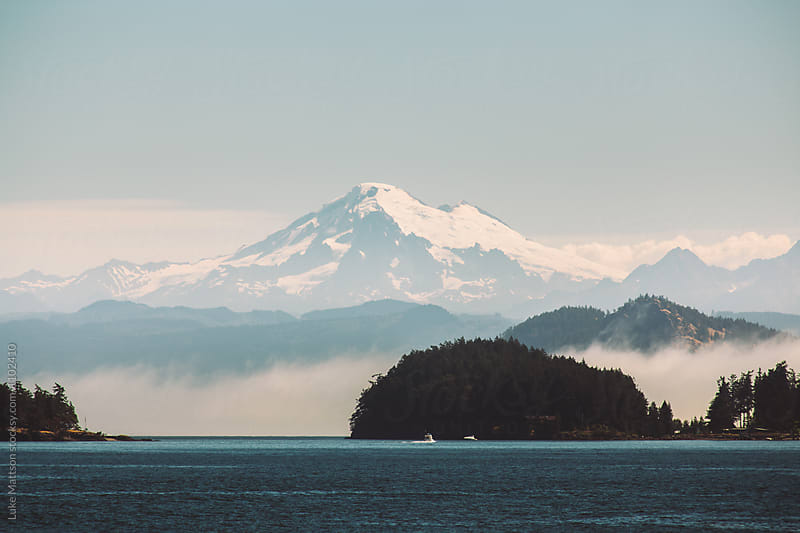 View Of Mount Baker From Midst Of San Juan Islands In Pacific Oc by Luke Mattson for Stocksy United