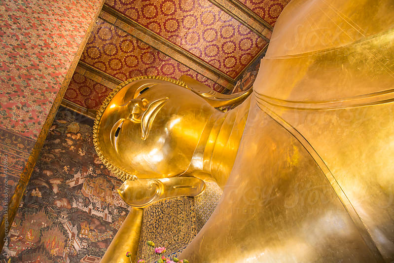 Leaning Buddha in Wat Po by Diane Durongpisitkul for Stocksy United