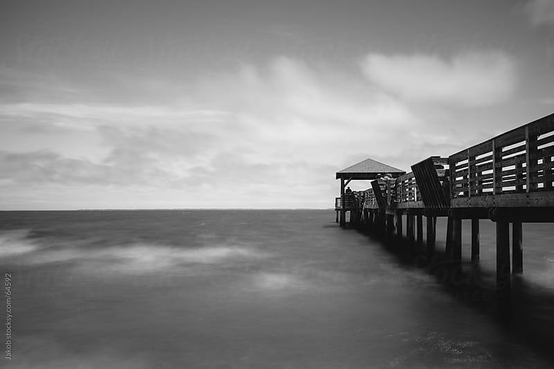 Pier over ocean by Jakob for Stocksy United