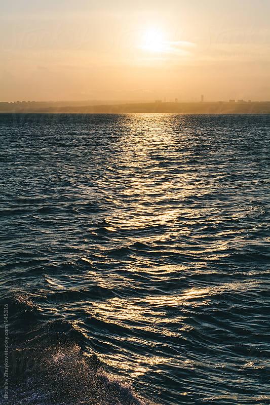 Splashing waves on sunset by Borislav Zhuykov for Stocksy United