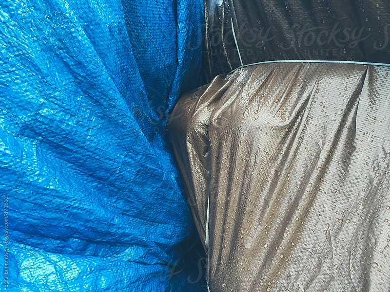 Close up of industrial tarps covering commercial fishing gear by Paul Edmondson for Stocksy United