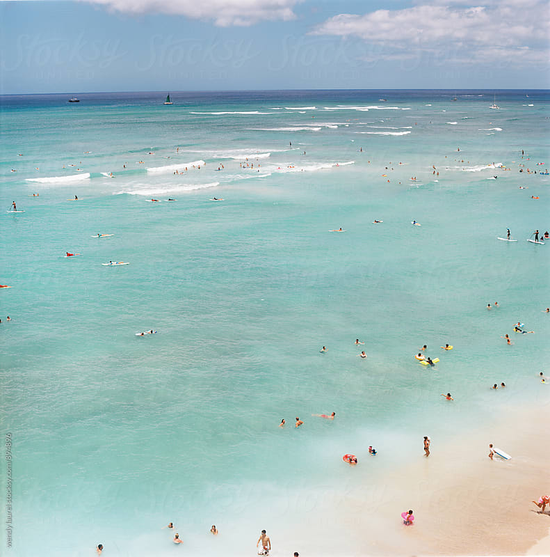 waikiki scene on the beach and ocean on film by wendy laurel for Stocksy United