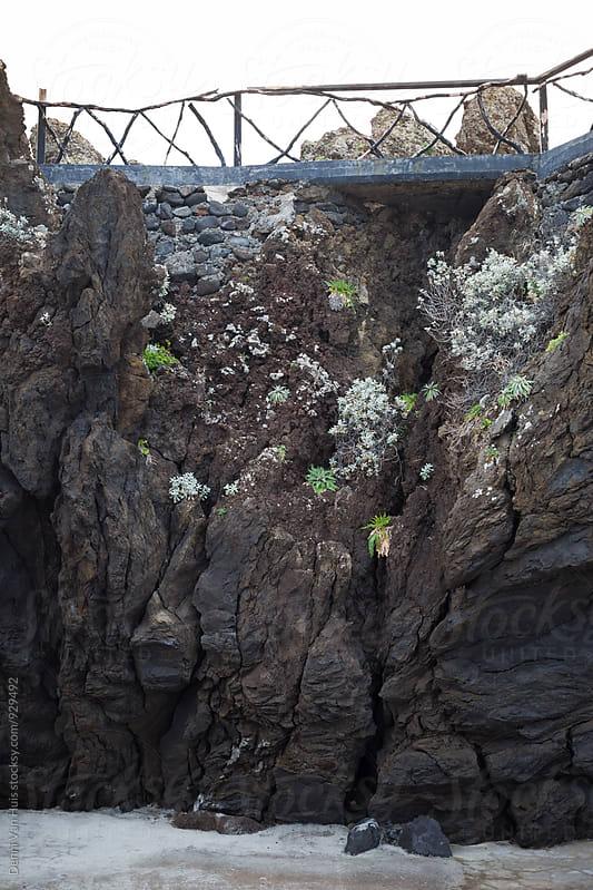 railing on top of rock by Denni Van Huis for Stocksy United