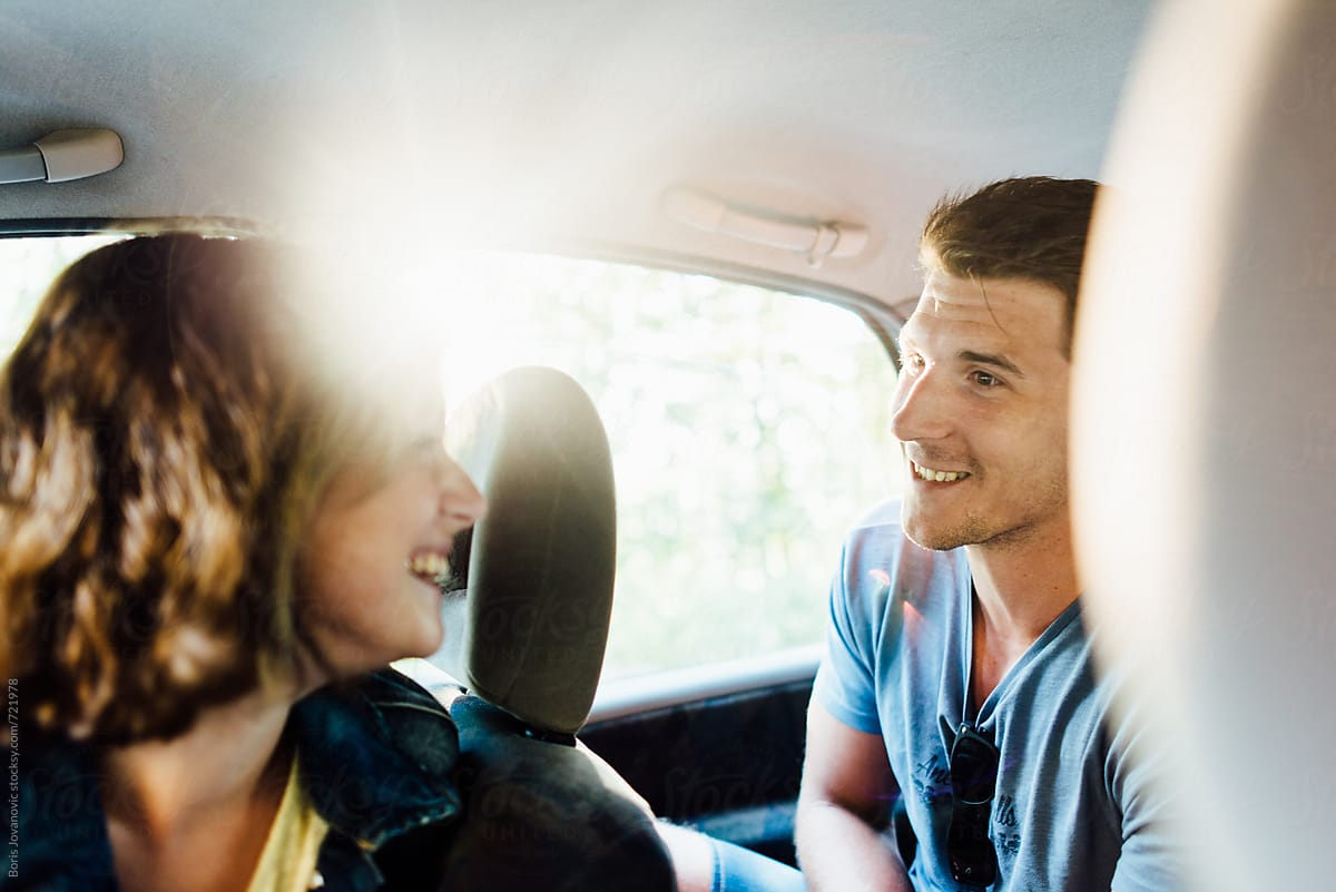Stock Photo - Two Friends Having A Fun Conversation In Car