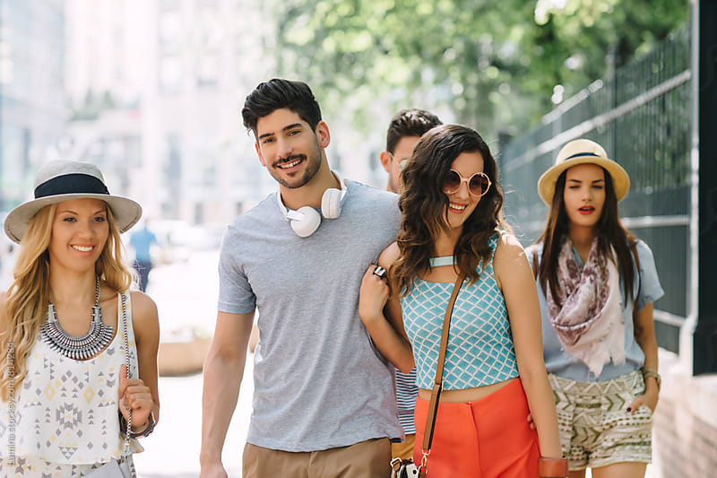Couple With Friends Walking on the Street by Lumina for Stocksy United
