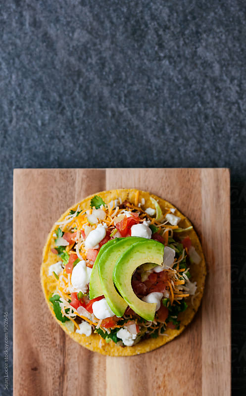 Tacos: Overhead View Of Ground Beef Tostada With Copyspace by Sean Locke for Stocksy United