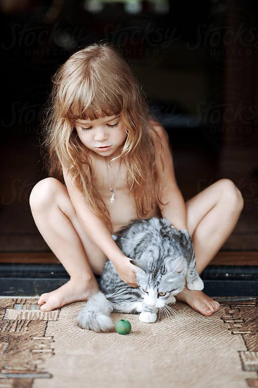 Little girl and her tabby kitten by Svetlana Shchemeleva for Stocksy United