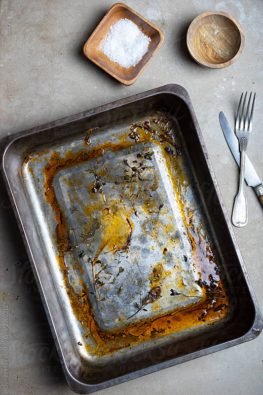 Dirty oven tray. by Darren Muir for Stocksy United