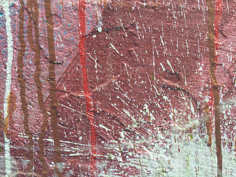 Splattered paint and graffiti on building wall, close up by Paul Edmondson for Stocksy United