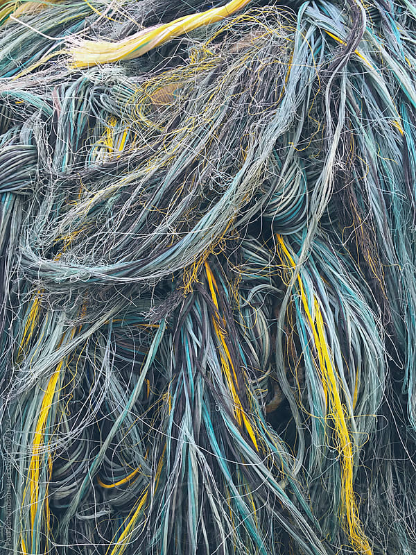Close up of pile of ropes and commercial fishing nets by Paul Edmondson for Stocksy United
