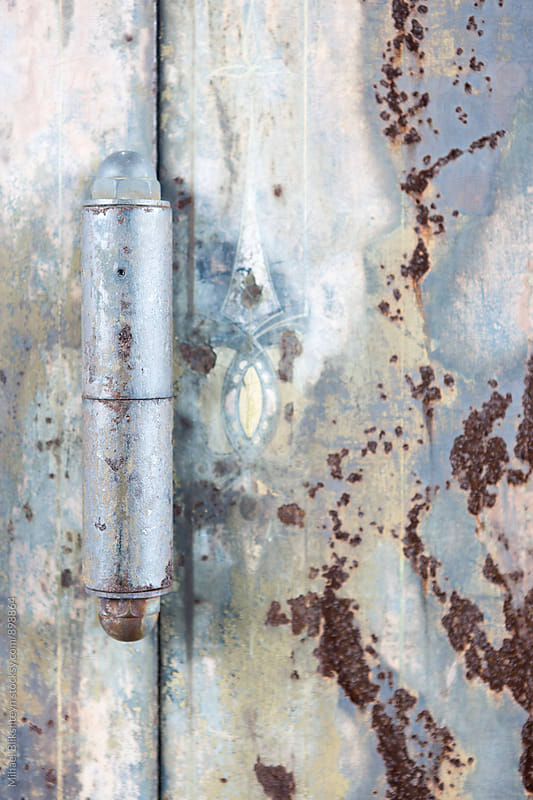 Closeup of a metal rusted door hinge on a safe by Mihael Blikshteyn for Stocksy United