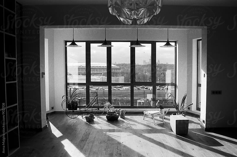 A black and white film photo of window with a view on Moscow by Anna Malgina for Stocksy United