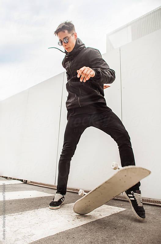 Skateboarder doing tricks . by Audrey Shtecinjo for Stocksy United