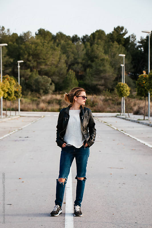 Young woman on the street by Susana Ramírez for Stocksy United