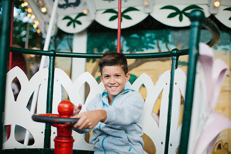 Boy on a Carnival Carousel  by Zocky for Stocksy United