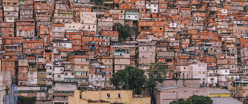 A mass of favelas (slums) on a hillside in Rio de Janeiro by Adrian Seah for Stocksy United